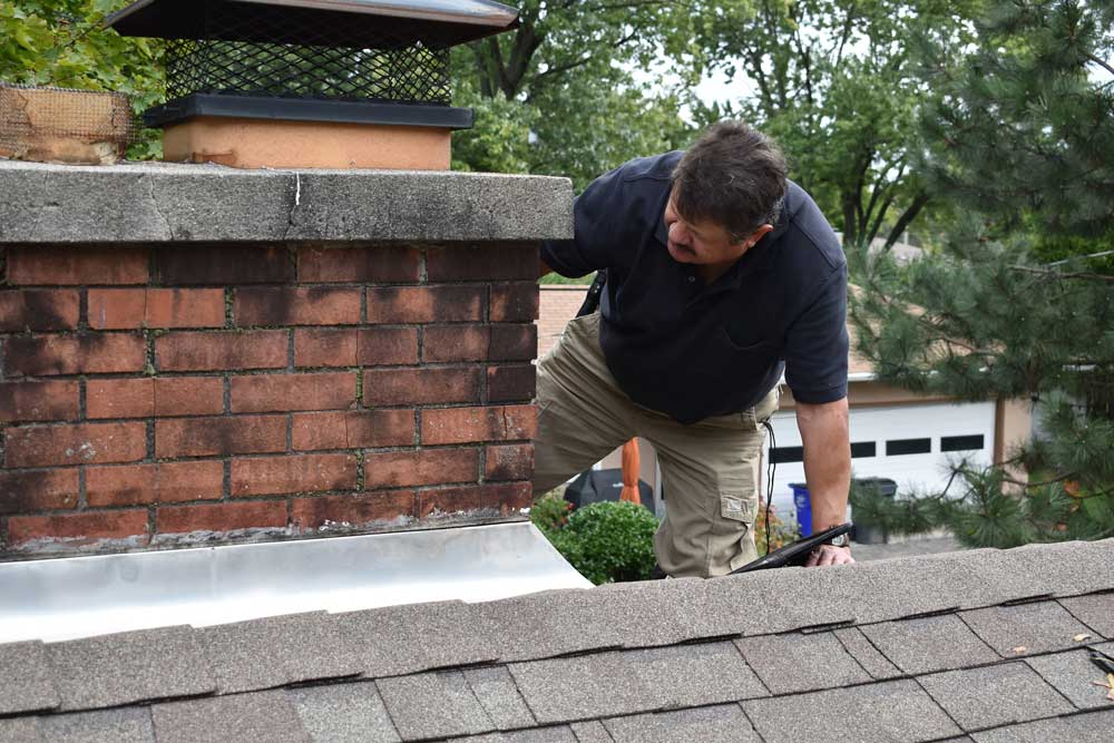John Myers carefully inspecting a roof